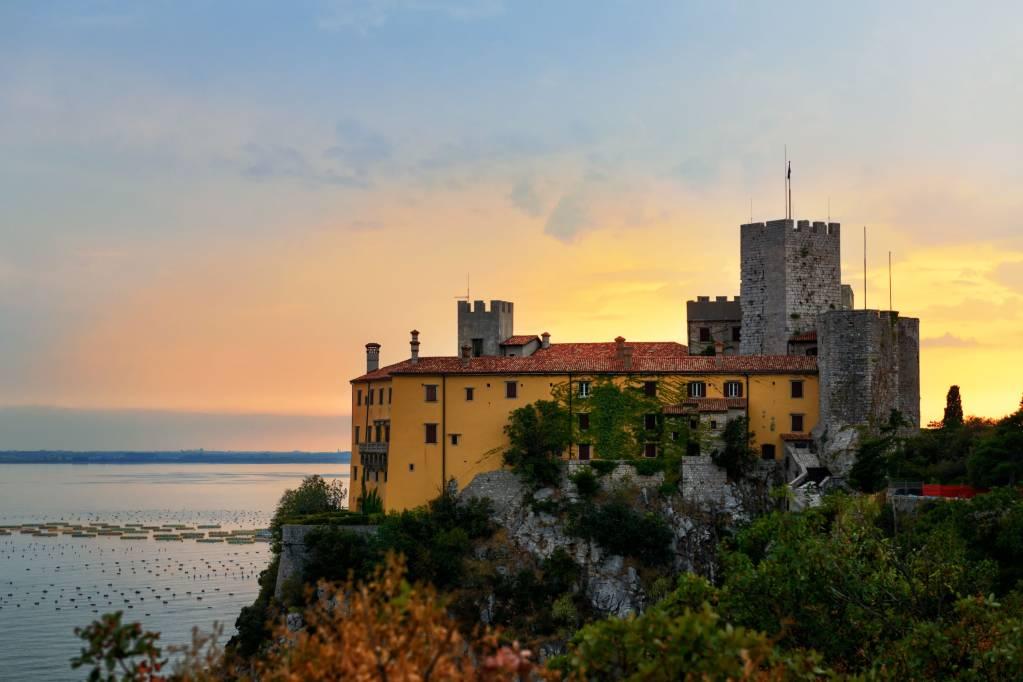 Old castle Duino in Italy near Mediterranean sea