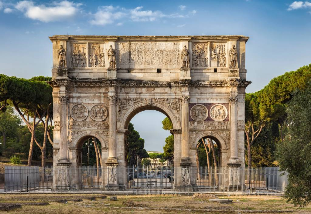 The Arch of Constantine is a triumphal arch in Rome, situated between the Colosseum and the Palatine Hill.
