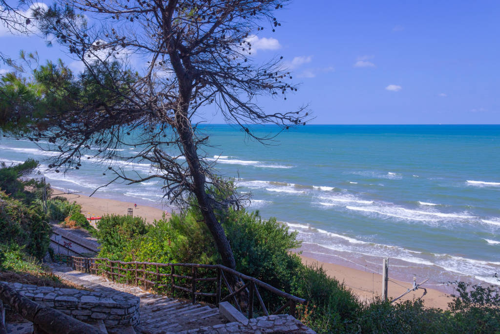 Apulia coast: The beach of Cento scalini (One hundred steps) located between Rodi Garganico and Peschici and the final part of San Menaio, Italy.