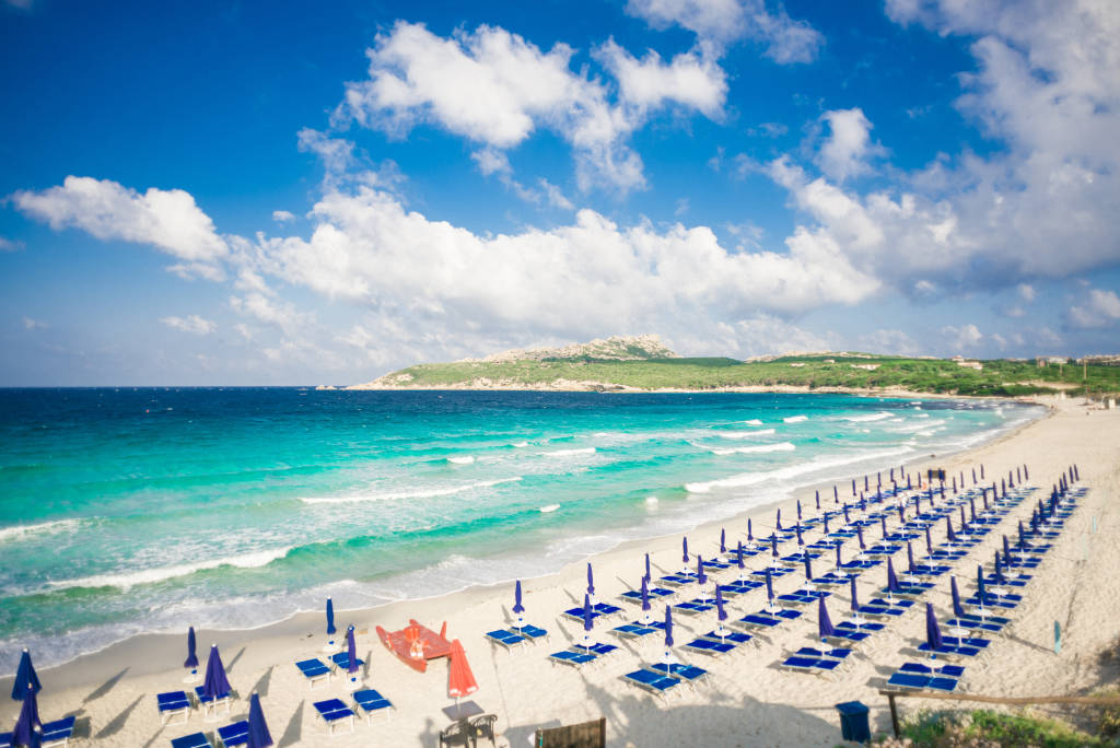 Beach of Rena di Ponente, Sardinia Island, Italy. Blue Sky. La Colba Bay.