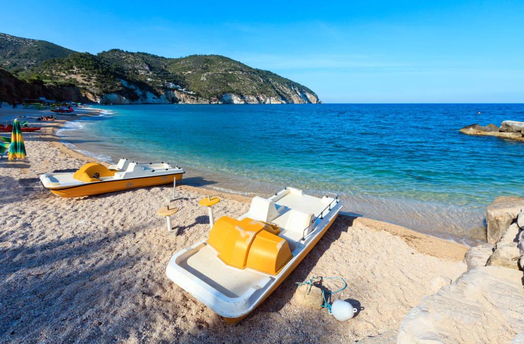 Summer Adriatic Sea beach Contrada Mattinatella (Spiaggia di Mattinatella, Fontana delle Rose) on the Gargano peninsula in Puglia, Italy. People unrecognizable.