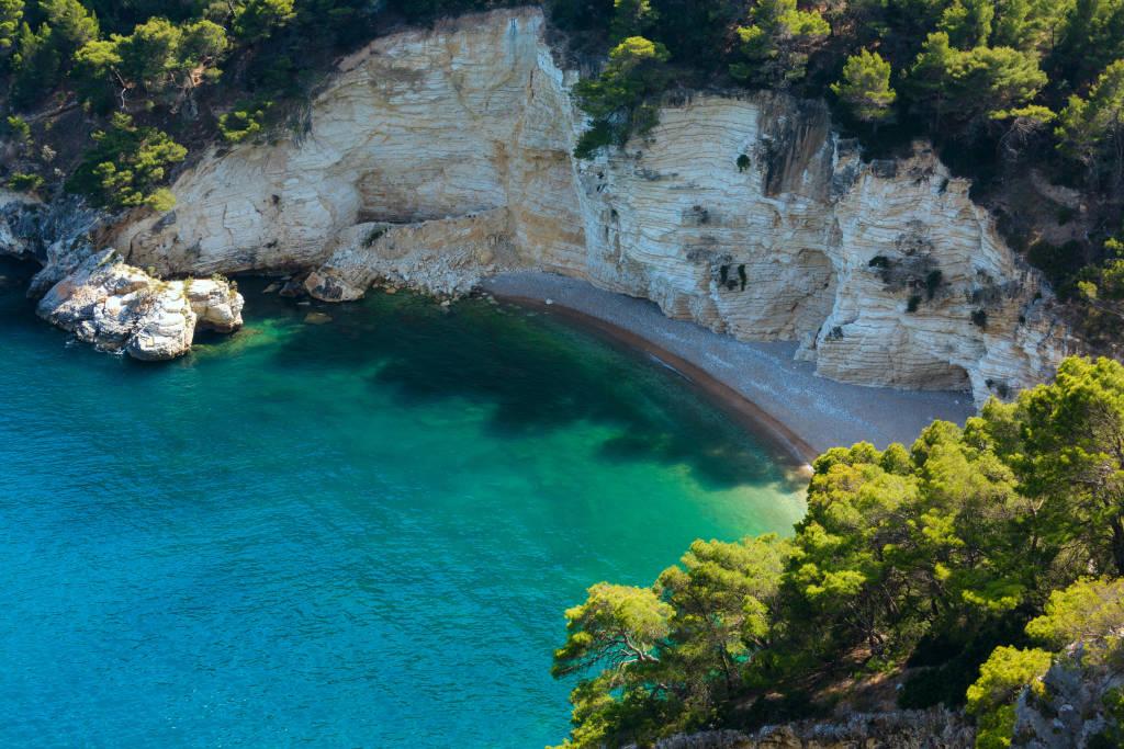 Summer calm beautiful beach Cala di Porto Greco on the Gargano peninsula in Puglia, Italy. View from Torre dell'Aglio.