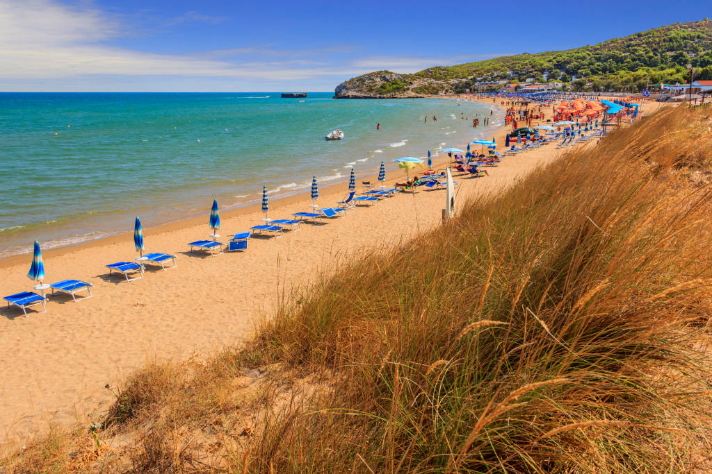 The most beautiful beaches of Apulia: Manaccora Bay, enclosed by two rocks, stretches a few kilometres away from Peschici, in Gargano, Italy.