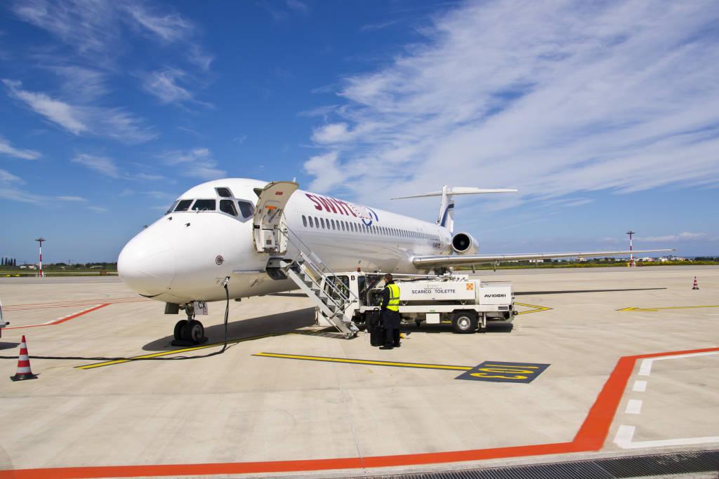 BARI, ITALY -APRIL 14: A Swiftair aircraft at the Karol Wojty?a Airport on April 14, 2012 in Bari, Italy.