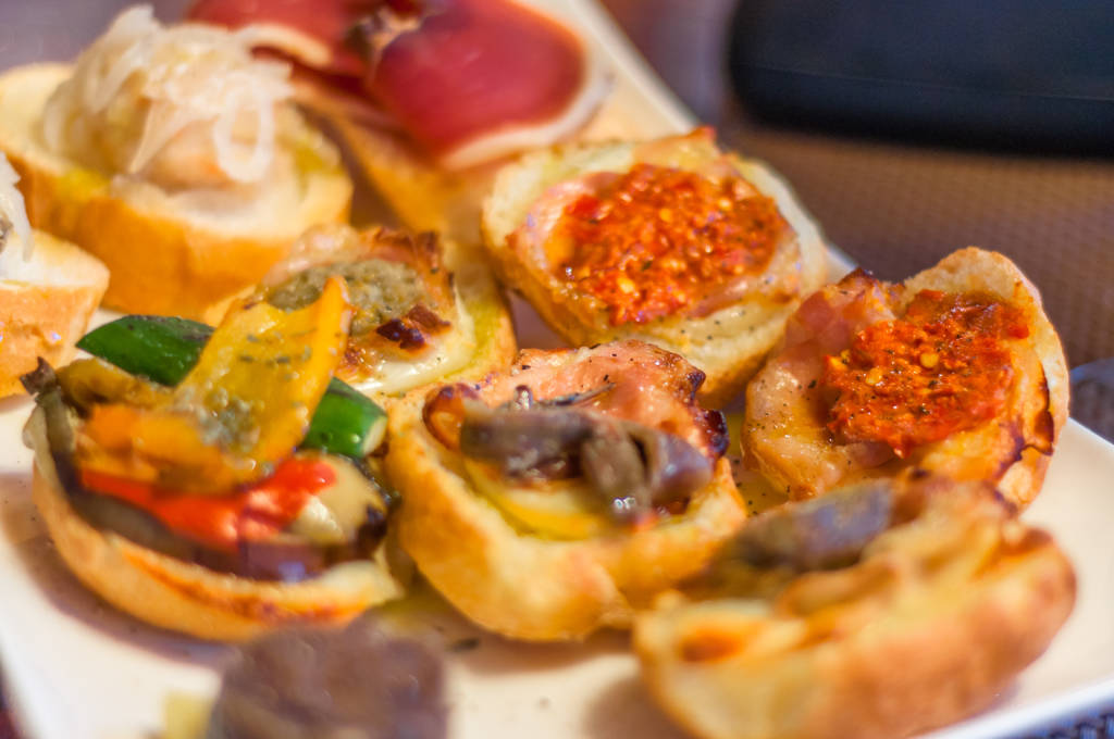 Cicchetti are small snacks served in traditional bars in Venice