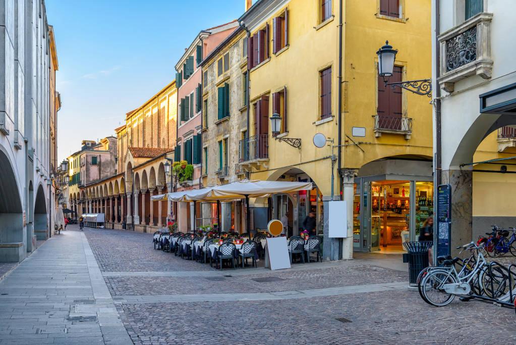 Old street with tables of pizzeria in Padua (Padova), Veneto, Italy. Cozy cityscape of Padua.