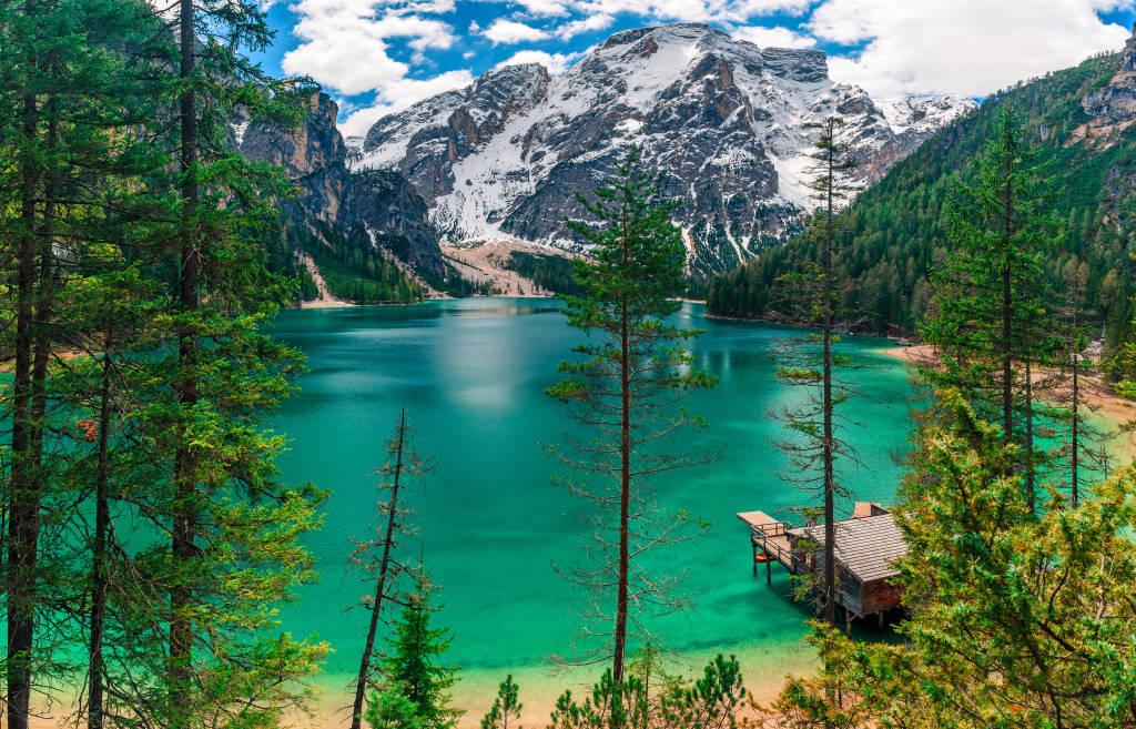 Panorama of Braies Lake in Dolomites mountains, Sudtirol, Italy. Beautiful Alpine lake Lago di Braies in sunny day