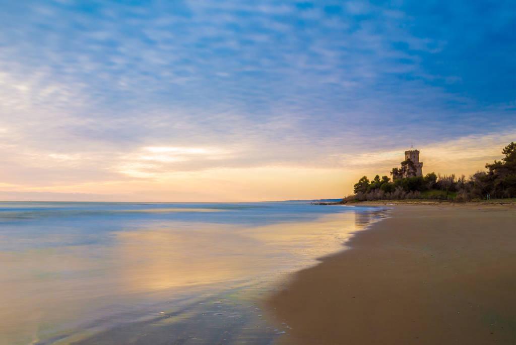 Pineto (Abruzzo, Italy) - The sunrise on the Adriatic sea, from the Pineto beach, beside the Torre di Cerrano castle