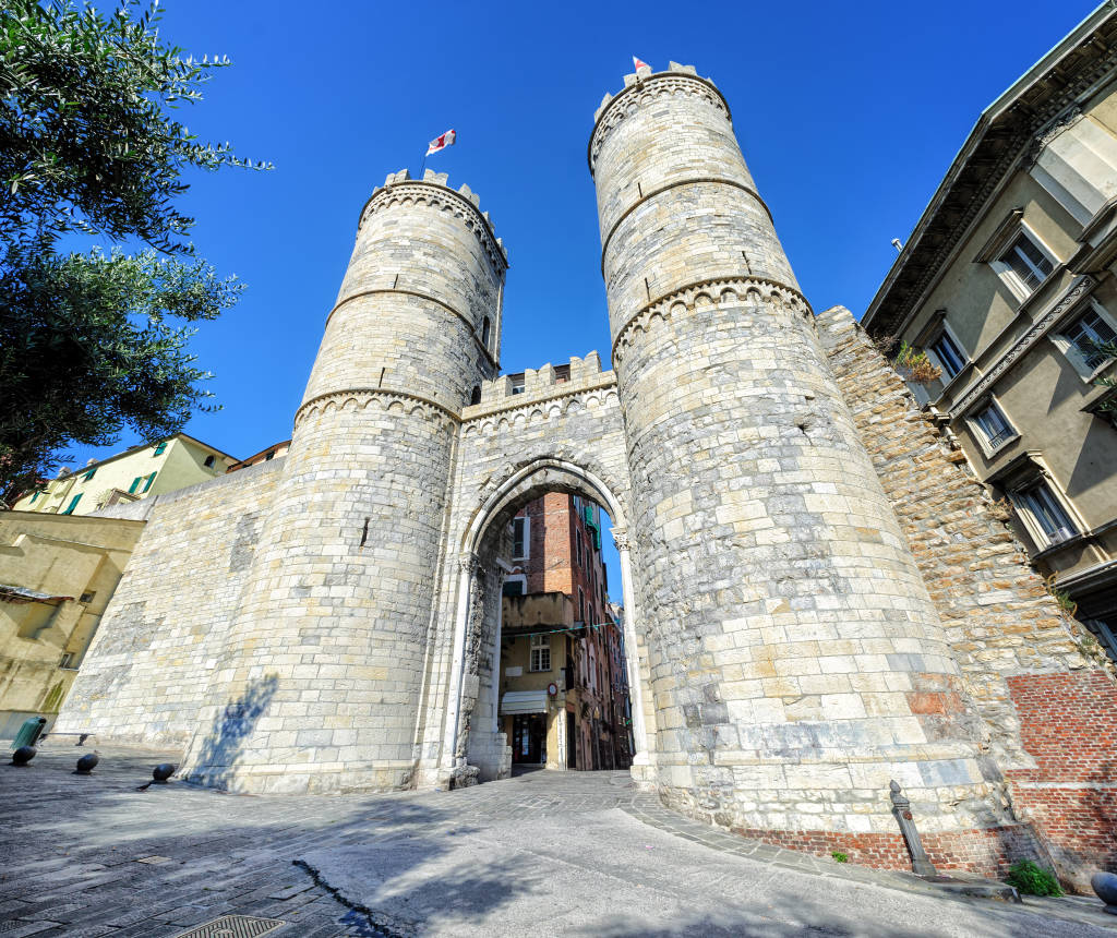 Porta Soprana, a two tower medieval city gate of Genoa's old town, Italy
