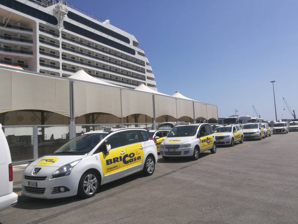 Taxi Car Parked in the Port near a Cruise Ship in Bari,Italy-July 2018