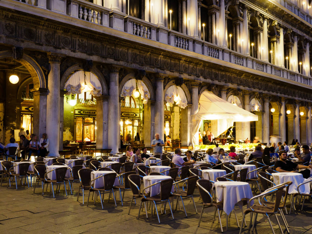 Venice, Italy - May 2018: Cafe Florian / Caffè Florian, founded in Venice in 1720. It is the oldest Café in the world situated in Saint Mark Square.
