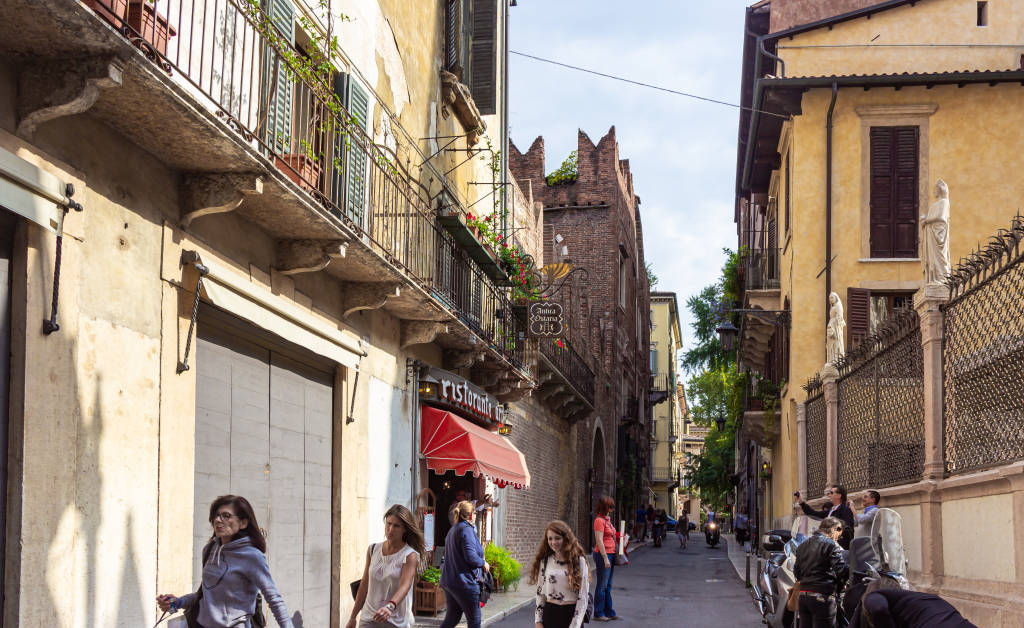 Verona, Italy - September 26, 2015 : Tourists walk the Via Arche Scaligere inspect the sights and photograph them in Verona, Italy