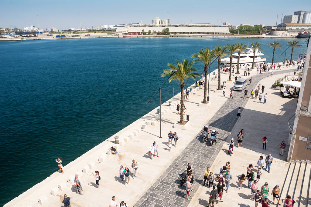 Brindisi, Italy - April 30, 2018: Promenade on the port of Brindisi and tourists