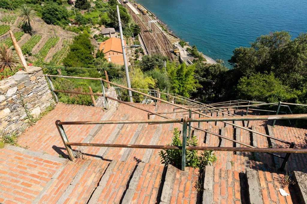 Corniglia, Cinque Terre, Liguria, Italy. June 2020. The long staircase that leads from the level of the railway station to the center of the village. Beautiful summer day.