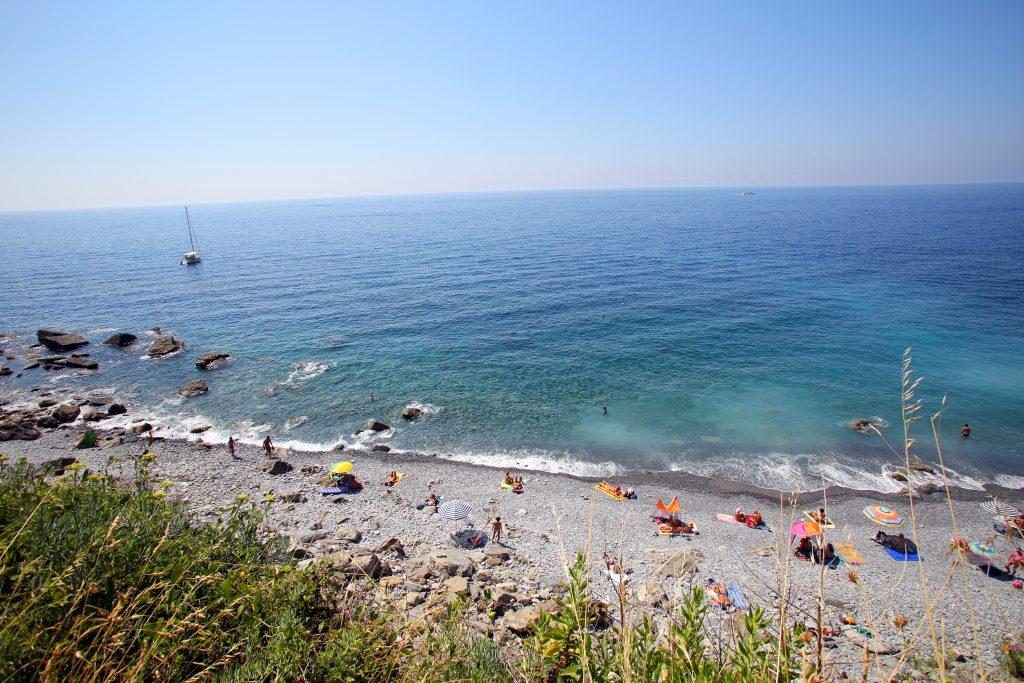 CORNIGLIA- ITALY: AUG 17: Bathers enjoy Guvano Beach, a known favorite among nudists, along the coast of Cinque Terre in Corniglia, Italy, on Sunday, August 17, 2013.