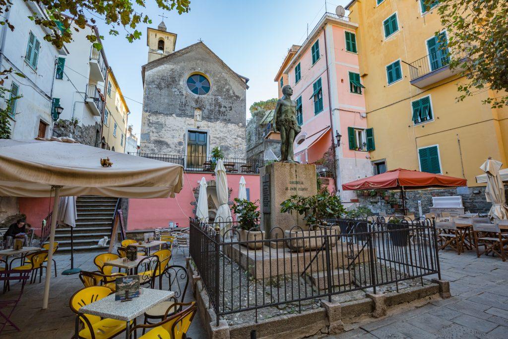 CORNIGLIA, ITALY - OCTOBER, 2020: cityscape. View of Chapel of Saint Catherine flagellants and The war memorial of the First World War in Corniglia village in Cinque Terre on the Italian Riviera
