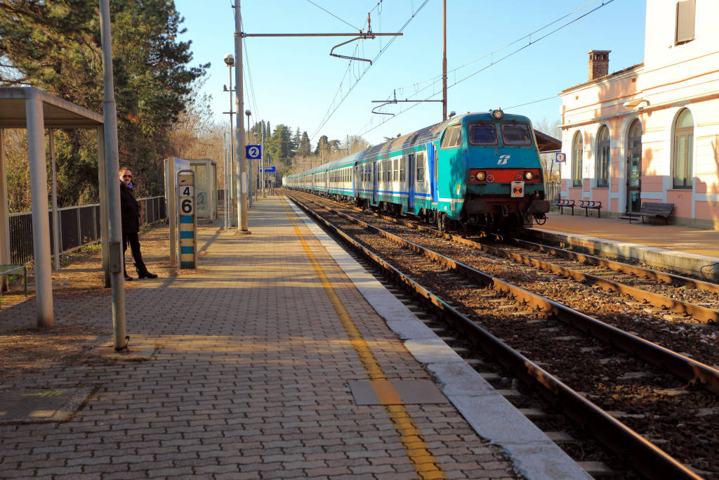 Trieste / Italy on Feb 16, 2013 person waiting train at railway station in the city