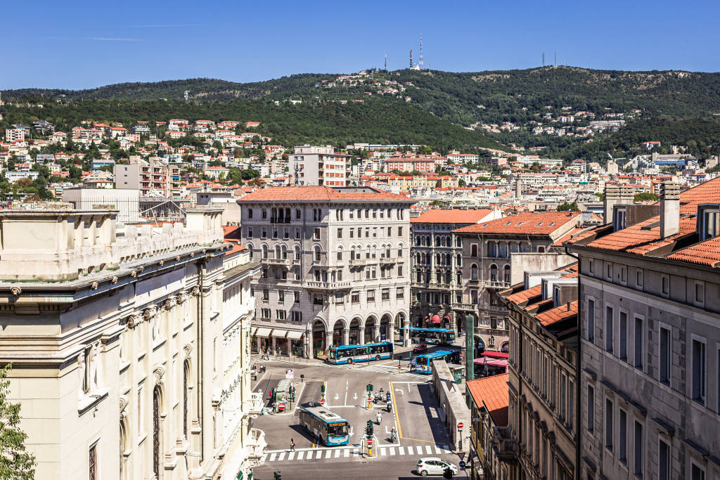 Trieste, Italy - September 2019: View of the piazza carlo goldoni from the scala dei giganti. Skyline, theater and university visible.