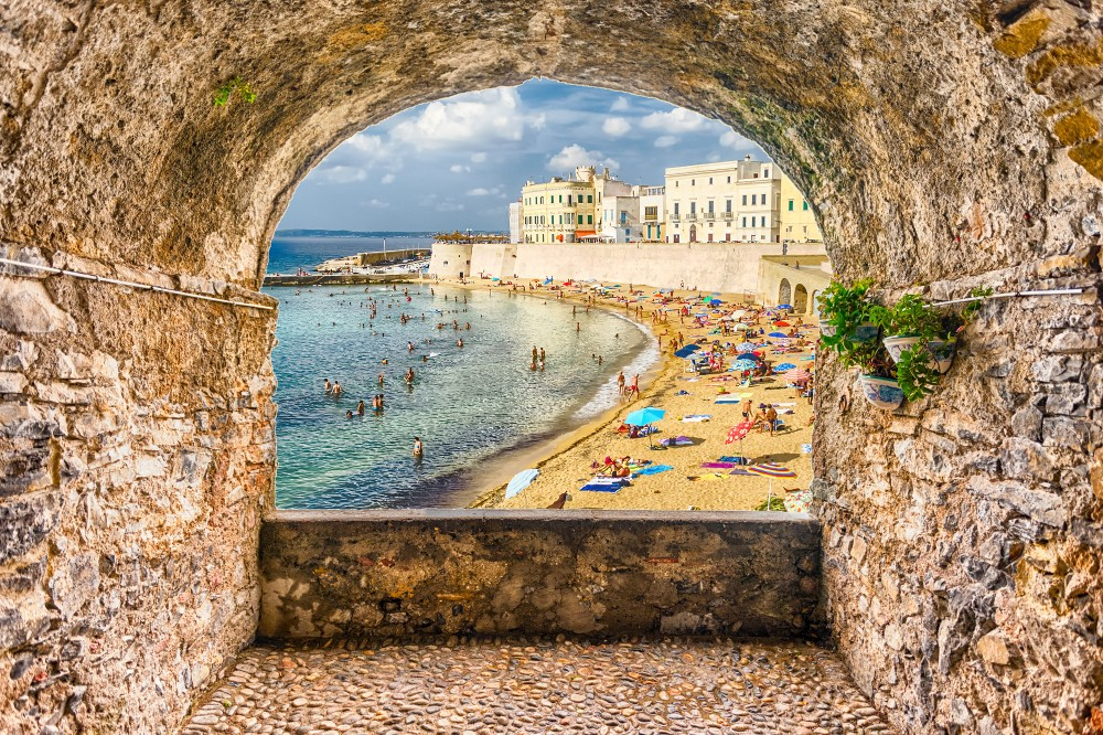 Scenic rock arch balcony overlooking Gallipoli waterfront, Salento, Apulia, Italy