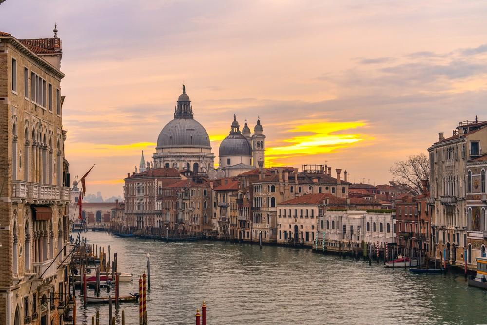Grand Canal and Basilica Santa Maria della Salute at sunset in Venice, Italy