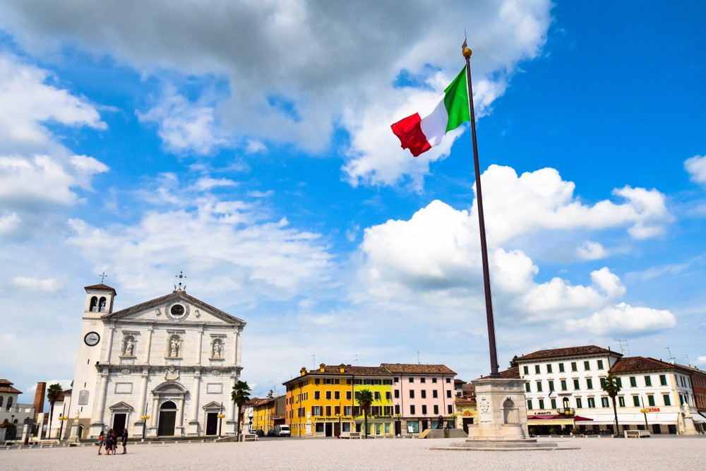 PALMANOVA,ITALY - AUG7,2019: Piazza Grande with the cathedral at Palmanova town which is a star fort of the late Renaissance.The fortifications were included in UNESCO's World Heritage list