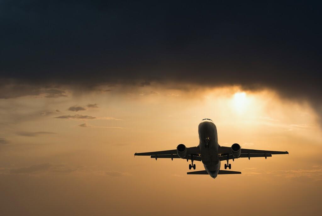 Plane,Goes,On,Takeoff,At,Sunset.,Landing,Plane,At,Sunset.