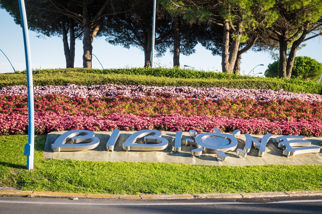 Welcoming,Bibione,Sign,On,The,Roundabout,Entering,The,City