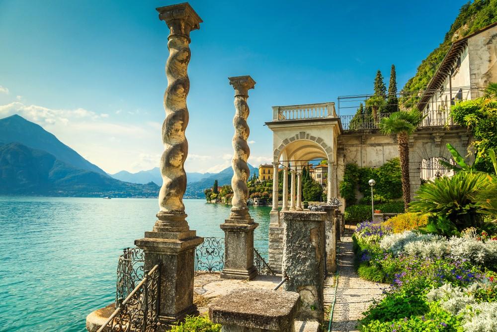 Fantastic luxury villa Monastero, stunning ornamental botanical garden, decorated with colorful mediterranean flowers, lake Como, Varenna, Lombardy region, Italy, Europe