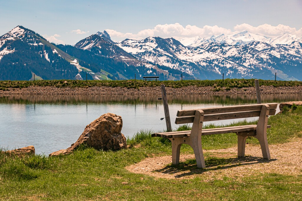 Beautiful alpine view with a lake with reflections at Hohe Salve summit - Söll - Tyrol - Austria