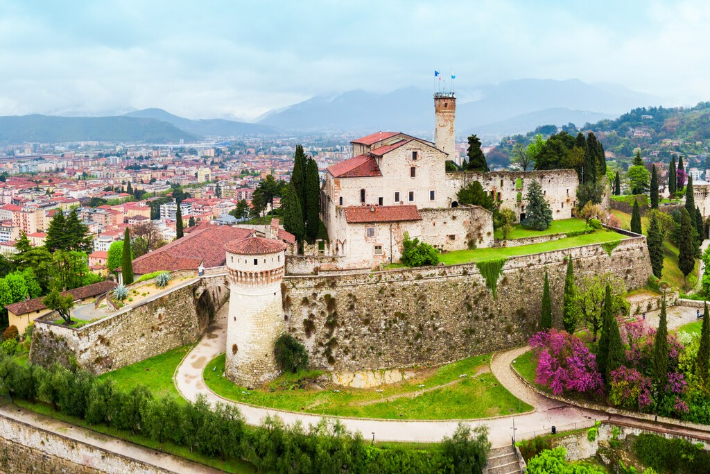Brescia Castle aerial panoramic view. Castle of Brescia is a medieval castle locate atop Cidneo Hill in Brescia city in north Italy.