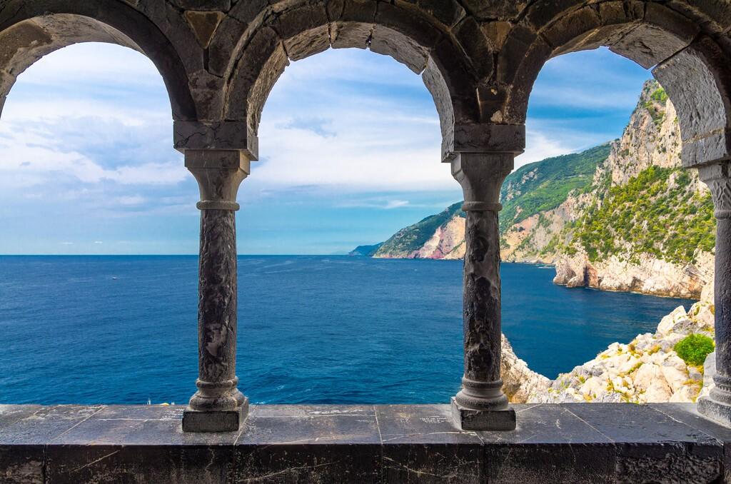 Grotta di Lord Byron, coast with rock cliff through external arch colonnade Church San Pietro, Portovenere, Ligurian sea, Riviera di Levante, National park Cinque Terre, La Spezia, Liguria, Italy