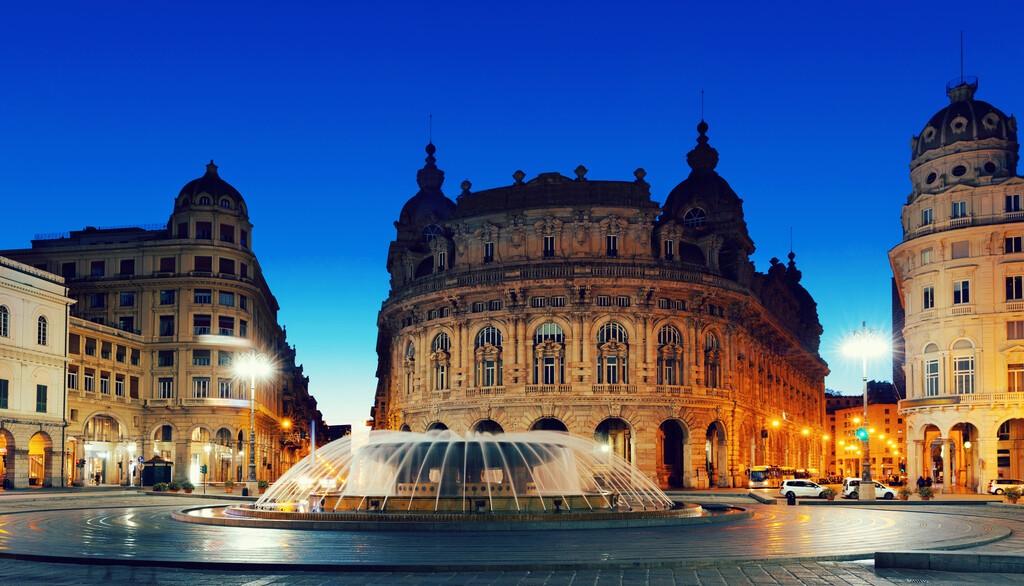 Impressive architecture and fountain Piazza De Ferrari at dusk, Genoa, Italy