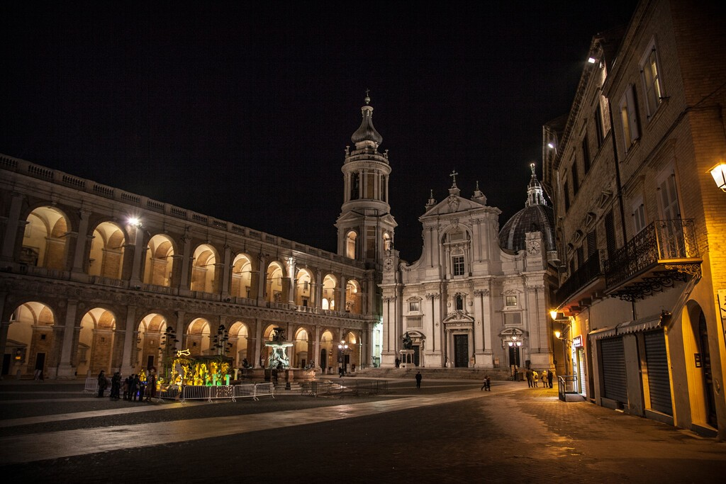 The beautiful city of Recanati, Macerata, Marche, Italy during the night with all the streets, fountains, architecture and buildings enlightened