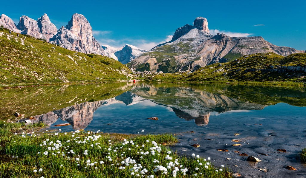 Wonderful sunny landscape of Dolomite mountains in summer. National Nature Park Tre Cime In the Dolomites Alps. Beautiful nature of Italy.